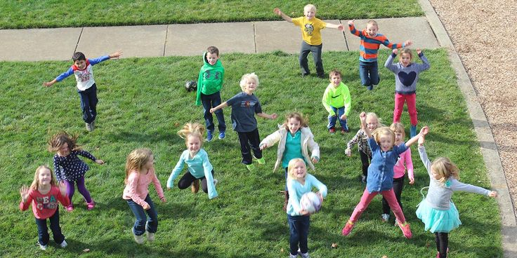 ACS kids jumping on the grass