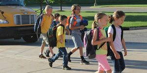 elementary -kids -bus -walking in
