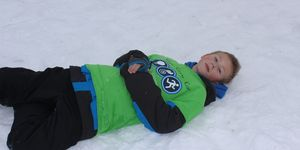 middle school -boy -snow -laying down