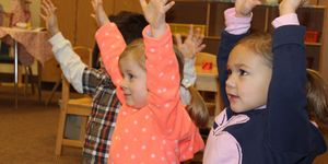 preschool -girls -hands raised