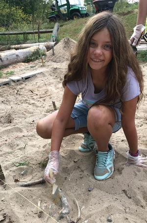 Enlarge image Girl uncovers bones